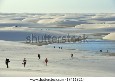 Maranhao state, Brazil - August. 21. 2010 : Lencois Maranhenses National Park, Brazil, low, flat, flooded land, overlaid with large, discrete sand dunes with blue and green lagoons - stock photo