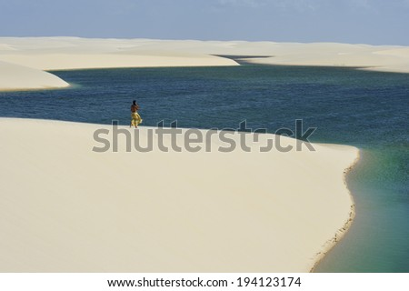 Maranhao state, Brazil - August. 21. 2010 : Lencois Maranhenses National Park,Brazil, low, flat, occasionally flooded land, overlaid with large, discrete sand dunes with blue and green lagoons - stock photo