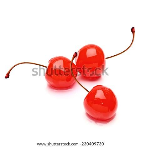 Maraschino cherries on white background - stock photo