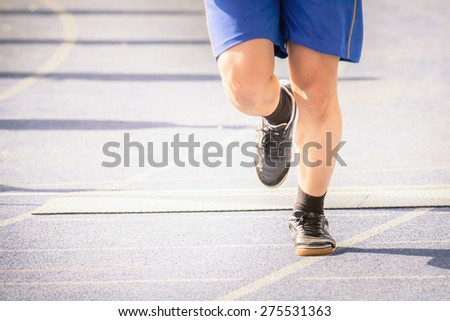 marathon of man's feet jogging outdoor by the road with copy space for text