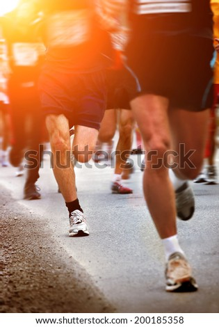 Marathon runners - blurred motion - stock photo