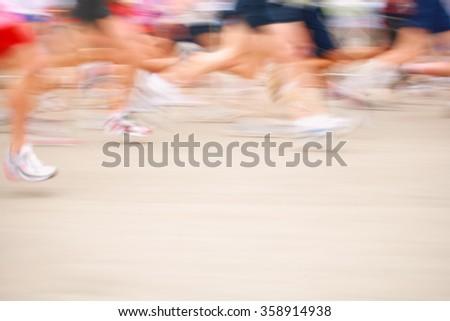 Marathon runners motion blurred image - stock photo
