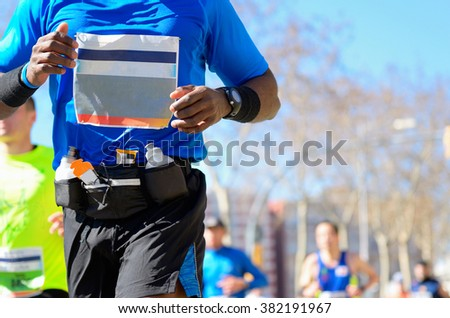 Marathon running race, black runner on road, sport, fitness and healthy lifestyle concept