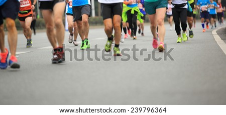 Marathon running race, people feet on city road  - stock photo