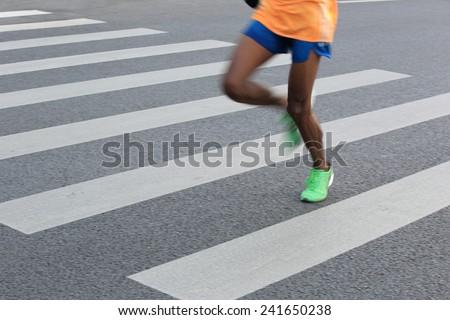 Marathon running race, people feet on city road  - stock photo