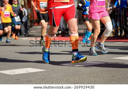 Marathon running race, runners feet on road, running with injury, sport, fitness and healthy lifestyle concept  - stock photo