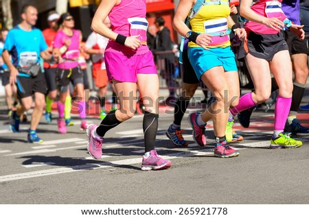 Marathon running race, women runners feet on road, sport, fitness and healthy lifestyle concept  - stock photo