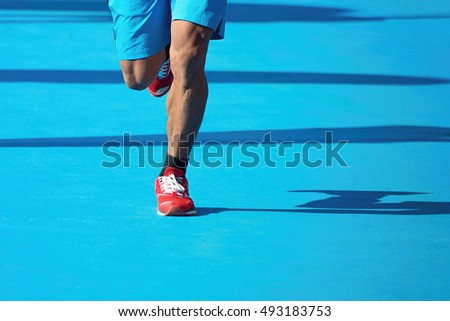 Marathoner running down the blue carpet
