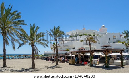 MARBELLA, ANDALUCIA/SPAIN - MAY 4 : View of the beach at Marbella Spain on May 4, 2014. Unidentified people. - stock photo