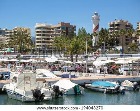 MARBELLA, ANDALUCIA/SPAIN - MAY 4 : View of the marina at Marbella Spain on May 4, 2014. Unidentified people. - stock photo