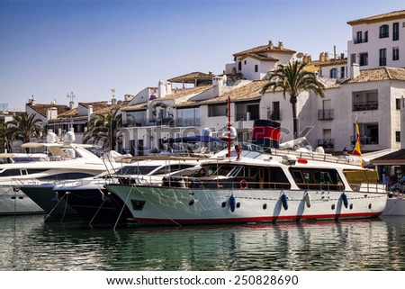 MARBELLA, SPAIN - JULY 11, 2013: Luxury yachts in Puerto Banus.  5 million annual visitors, and is popular with international celebrities. - stock photo