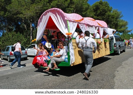 MARBELLA, SPAIN - JUNE 8, 2008 - Spanish people travelling in a caravan during the Romeria San Bernabe procession, Marbella, Costa del Sol, Andalusia, Spain, Western Europe, June 8, 2008. - stock photo