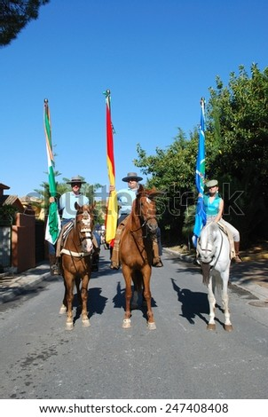 MARBELLA, SPAIN - JUNE 8, 2008 - Three flag bearers on horses during the Romeria San Bernabe procession, Marbella, Andalusia, Spain, June 8. 2008. - stock photo