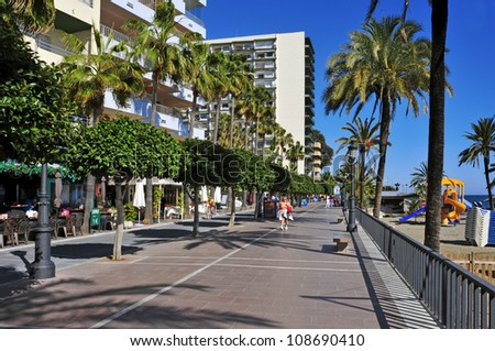 MARBELLA, SPAIN - MARCH 13: Seafront at Venus Beach on March 13, 2012 in Marbella, Spain. Marbella, with 27 km of coastline, has a Seafront about 7 km length - stock photo
