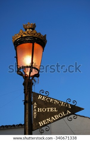 MARBELLA, SPAIN - MARCH 14, 2009 - Street light and hotel sign, Puerto Banus, Costa del Sol, Malaga Province, Andalusia, Spain, Western Europe, March 14, 2009. - stock photo