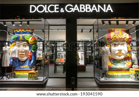 MARBELLA, SPAIN - MAY 1, 2014:  Dolce & Gabbana store in Puerto Banus, Marbella, Spain. Is a luxury industry fashion house. Was started by Italian designers Domenico Dolce and Stefano Gabbana. - stock photo