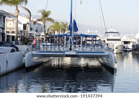 MARBELLA, SPAIN - OCTOBER 7: Puerto Banus on October 7, 2012 in Marbella, Spain. Puerto Banus is a tourist port in Europe on the Mediterranean Sea, which is World famous for their luxury yachts.  - stock photo