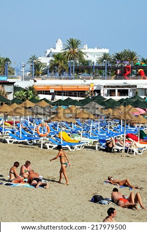 MARBELLA, SPAIN - SEPTEMBER 26, 2011 - Holidaymakers on the beach, Marbella, Costa del Sol, Malaga Province, Andalucia, Spain, Western Europe, September 26, 2011. - stock photo
