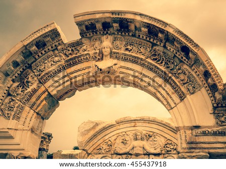 Marble arch and antique ruins of Hadrian's Temple in Ephesus - monumental landmarks of roman town. Archeology and ancient architecture of historical heritage in Turkey. - stock photo