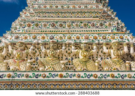 Marble architecture of demon warriors guarding the temple dome at Wat Arun temple in Bangkok, Thailand. - stock photo