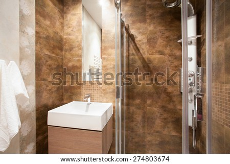 Marble bathroom with shower and sink - stock photo