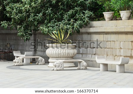 Marble benches in the park - stock photo