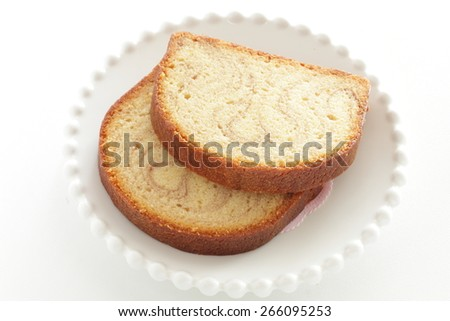 Marble caramel pound cake sliced on white dish