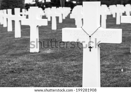Marble crosses in the american army cemetery in Normandy, France - stock photo