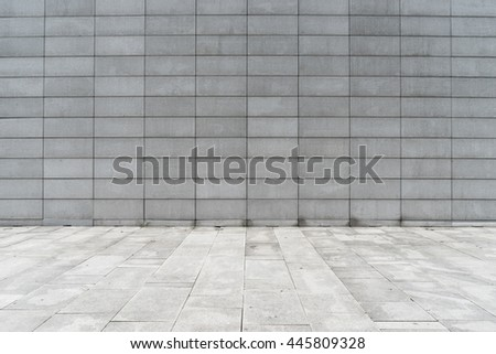 marble floor with brick wall