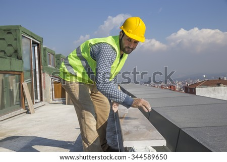 Marble Floor Worker . Paver with marble plates - stock photo