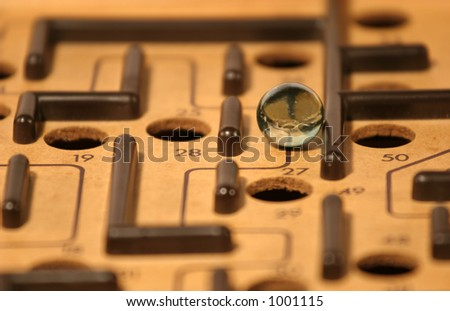 Marble in a maze - stock photo