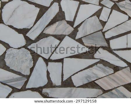 marble in concrete wall