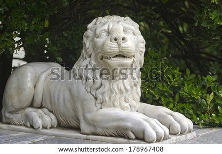 marble lion in city park - stock photo