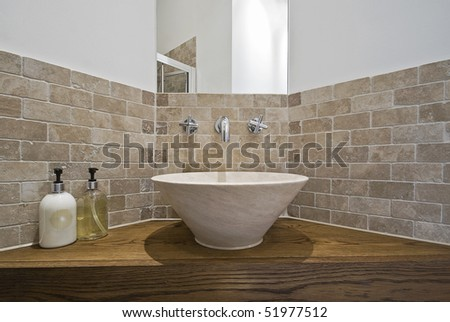 marble made hand wash basin on a wooden corner table - stock photo