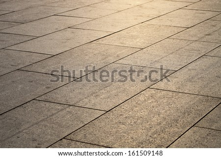 marble on the ground of city square  - stock photo
