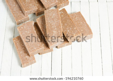marble pattern homemade soaps drying, bright wooden background - stock photo