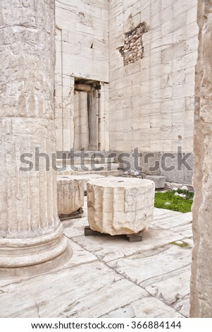 Marble remains of walls and columns  located in the Acropolis of Athens. Greece.