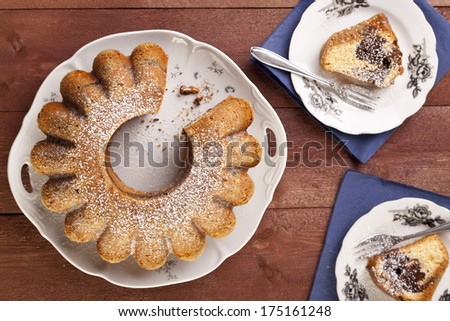 marble ring cake with a castor sugar and a cap of coffee - stock photo