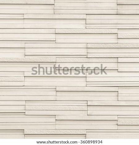 Marble rock tile wall w/ modern matte & polished detail patterned design interior decoration: Granite tiled detailed pattern texture background in natural light pastel cream creme beige color tone   - stock photo