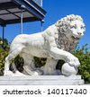 Marble sculpture of lion with ball in Vorontsov Palace in Alupka, Crimea, Russia. - stock photo