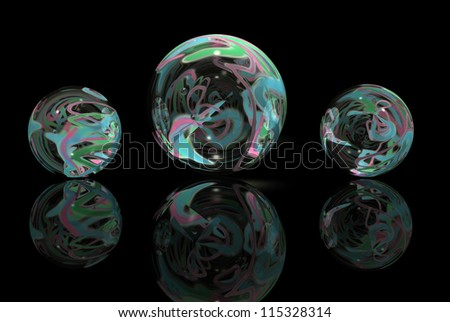 Marble shapes with colors against a black background and reflected in foreground.