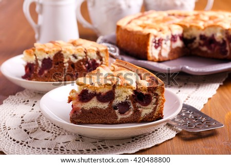 Marble sponge cake with cherry on plate