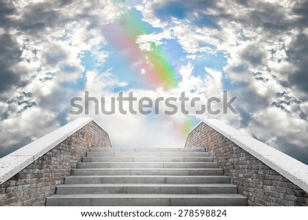 Marble staircase leading to the cloudy sky and rainbow - stock photo