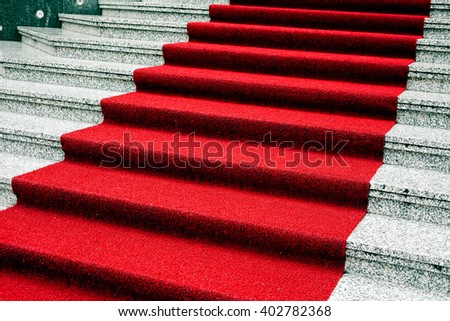 Marble stairs with red carpet, side view - stock photo