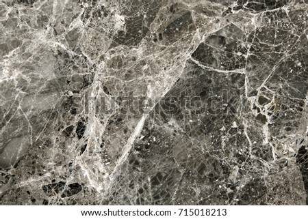 Marble stone texture with black, brown and white color, close-up
