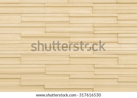 Marble tile wall texture detailed pattern background in light yellow cream beige brown color tone: Modern stone wall tiled patterned detail textured backdrop for interior design and decoration  - stock photo