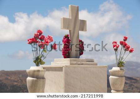 Marble tombstone in a cretan graveyard. Greek. Horizontal - stock photo