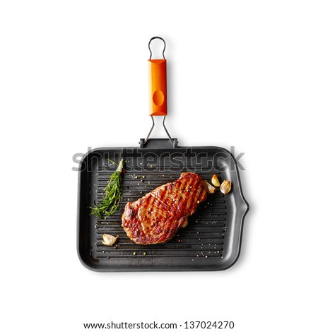 Marbled beef steak with herbs and spices in a grill pan. Isolated on white background. - stock photo