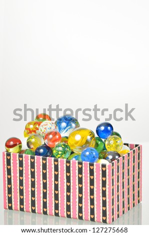 marbles balls in box - stock photo