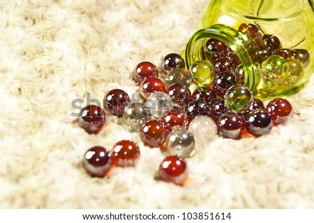 Marbles in a jar. - stock photo